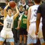 Senior Charlie Moreland looks for an open teammate to pass to downcourt. Photo by Luke Hoffman