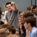 Senior Jack Melvin hypes up the senior class before the start of the pep assembly. Photo by Luke Hoffman