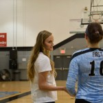 Coach Dalton coaches junior Brigid Wentz after she played in the first match. Photo by Catherine Esrey