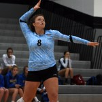 Senior Andie Mcconnell serves the ball. Photo by Kate Nixon