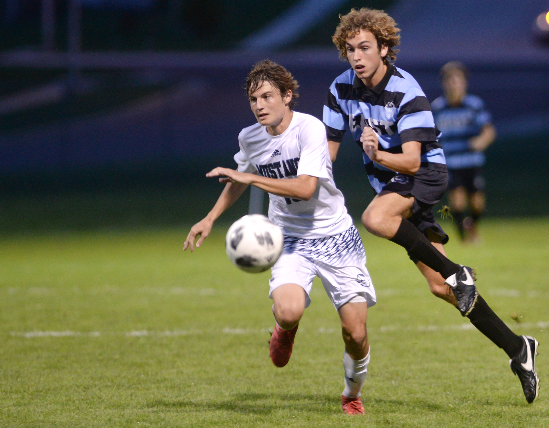 Junior Peter Kohring attempts to catch a BVN player. Photo by Luke Hoffman