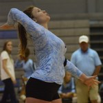 Senior Andie McConnell serves the ball.  Photo by Evelyn Roesner