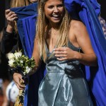 East alum and 2017 Shawnee Mission East Homecoming Queen Toni Englund puts the queen cape on senior Maggie Gray. Photo by Lucy Morantz