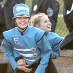 Junior Aislinn Kinsella and sophomore Angelica Klein play around before the game begins and the marching band performs. Photo by Luke Hoffman