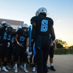 Senior Deonte Carroll gets his team excited to go out on the field. Photo by Ty Browning