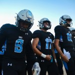 Seniors Rashaun Burney, Joseph Mohr and Andy Maddox walk out onto the field from the locker room. Photo by Ty Browning