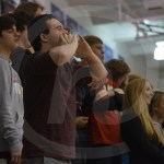 Senior Jack Melvin cheers for the Lancer, varsity basketball players from the student section.  Photo by Taylor Keal.