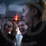 Seniors Madison Mustoe and Taylor Fort, and Sophomore Anabelle Merchant talk on the bus ride to the game. Photo by Megan Biles