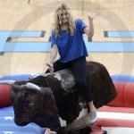 Junior Addison Wiklund rides the bull. Photo by Julia Percy