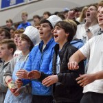 Senior PJ Spencer, along with other Lancer supporters, cheer as SME fights to make a comeback. Photo by Luke Hoffman