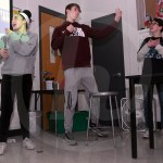 Sophomores Tonie Cloutier, Trevor Paulus, and Oliver Mannell sing along to a Chinese song. Photo by Kate Nixon