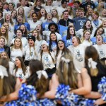 After the the final whistle and fall of the Lancers to the Hawklets by a score of 44-60, the student section and cheerleaders sing the school song before exiting the Rockhurst gymnasium. Photo by Lucy Morantz