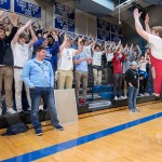 Senior Daniel Hammond leads the student section in the 'Viking' chant in the fourth quarter. Photo by Lucy Morantz