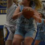 Junior Sydney Crane searches for the basket to attempt a layup. Photo by Noelle Griffin