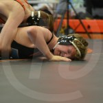 Freshman Cole Hasenzahl gets pinned on the mat by his opponent. Photo by Taylor Keal