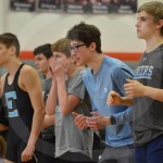 Sophomore Joseph Dalton, freshman Charlie Kallemeier, sophomore Max Smiley and Sophomore Nate Curry watch their teammate, Sophomore Jerald Young, in the last few seconds of his tied match. Photo by Taylor Keal