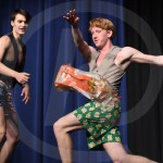 A bag of bread goes flying after seniors Sebastian Bruck and Quin Napier karate chop it during their talent act. Photo by Aislinn Menke