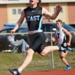 Senior Bradley Loveland runs in the Boys 100 Meter Dash. Photo by Annakate Dilks