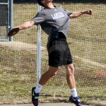 Freshman Trace Huston swings the discus. Huston placed 1st in this event. Photo by Megan Biles
