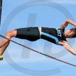 Senior Alec Schlote goes over the Pole Vault bar during his second attempt. Photo by Megan Biles