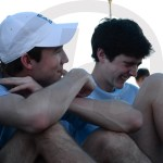 Sophomore Keaton Duckworth and Calvin Cattaneo laugh and talk after they finish their match. Photo by Julia Percy