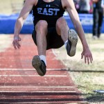 Junior Peter Kohring prepares himself to land in his third attempt in triple jump. Photo by Lucy Morantz