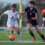 Senior Emily Cooper dribbles the ball away from her opponent to later score in the second half. Photo by Dakota Zugelder