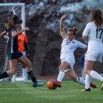 Junior Josephine McCray goes in for a slide to get the ball away from the goal. Photo by Dakota Zugelder