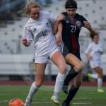 Junior Camryn Gossick fights to keep the ball away from an attacker. Photo by Dakota Zugelder