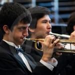 Junior Sam Vaughn warms up with the group on trumpet. Photo by Dakota Zugelder