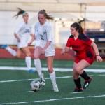 Junior Camryn Gossick takes the ball from a defender. Photo by Dakota Zugelder