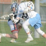 Sophomore Will Wynn takes the draw and flings it out so another midfielder can catch it. Photo by Noelle Griffin