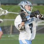 Senior Charles Boerger passes the ball to another attackman. Photo by Noelle Griffin