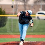 Senior Max Smith pitches to an Olathe East player during the second inning. Photo by Megan Biles