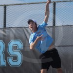 Sophomore Keaton Duckworth serves the ball during his doubles match. Photo by Megan Stopperan