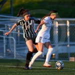 Junior Isabella Velez tries to get the ball from her opponent. Photo by Megan Stopperan