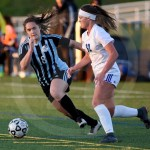Junior Karoline Nelson rushes to steal the ball from an Olathe Northwest player. Photo by Megan Stopperan