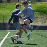 Senior Jack McElroy jumps to kick the ball away from the defender, senior Charley Colby. Photo by Taylor Keal