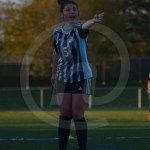 Junior Caroline Chisholm yells to the referee the ball should be their's after he calls ONW ball. Photo by Taylor Keal