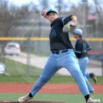 Senior Max Smith pitches to an Olathe East player. Photo by Julia Percy