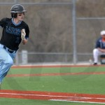 Freshman Patrick Bergkamp runs to first base after batting. Photo by Julia Percy