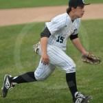 Junior Jack Marasco runs to get a bunt ball. Photo by Sarah Golder