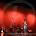 """Sophomore Anna McQueeny sings lead during """"Bennie and the Jets"""" to begin the set. Photo by Ty Browning"""