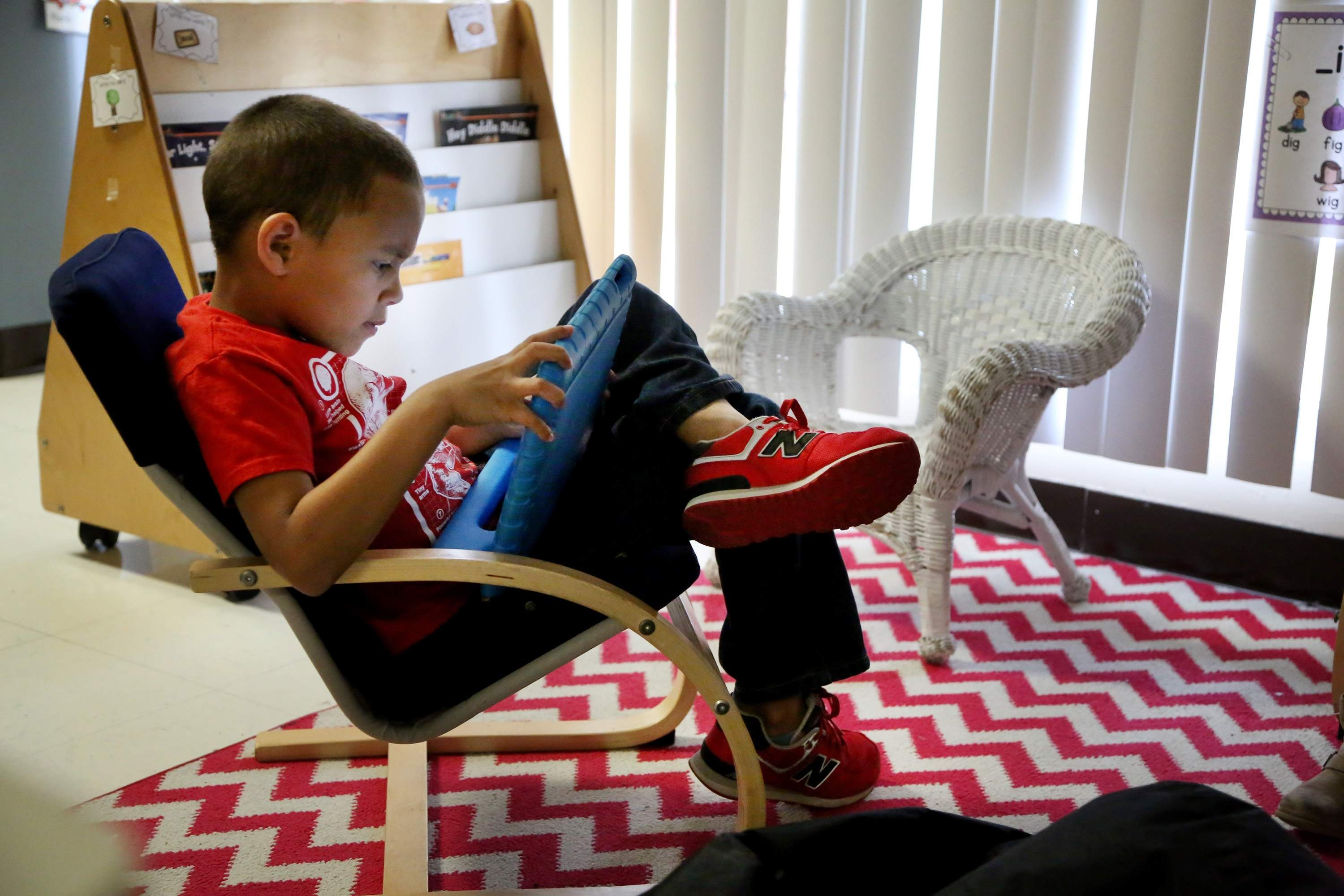 Chester Taylor Elementary School kindergartener Urijah Smiley, 5, used an iPad to access an reading application, Bookshelf, while practicing reading on Jan. 23, 2018, at the school in Zephyrhills.