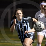 Junior Karoline Nelson focuses on the ball while trying to gain speed on her opponent. Photo by Kate Nixon