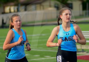 Sophomores Grace Strongman and Ragan Dutcher stick together throughout the two mile. Photo by Evelyn Roesner