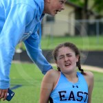 Sophomore Paige Puegeot comforts sophomore Grace Strongman after the two mile. Photo by Evelyn Roesner