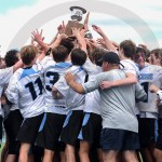 After winning the championship, the whole team crowded around the trophy when it was given to them. Photo by Julia Percy