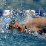 Senior Trinity Legill takes a breath during the 100 yard freestyle. Legill placed fourteenth with a finals time of 56.75. Photo by Kate Nixon