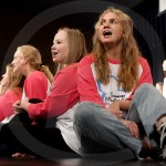 """Sophomores Riley Riecker and Sydney Decker perform """"When Will My Life Begin"""" with the Women's Choir. Photo by Kate Nixon"""